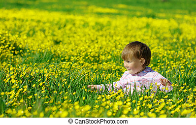 Cute child play on meadow