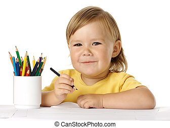 Happy child draw with crayons