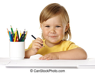 Child draw with crayons and smile
