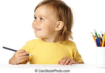 Happy child draw with crayons and smile