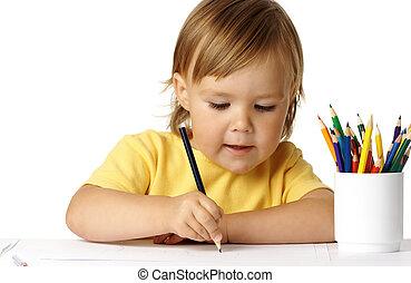 Cute preschooler focused on her drawing