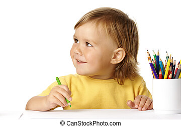 Cute child draw with crayons and smile