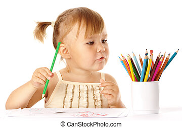 Cute child play with color pencils