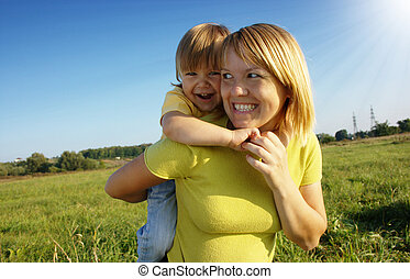 Mother and child play outdoors