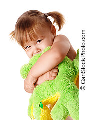 Cute girl embracing her soft toy - Cute little girl...