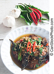 Thai Food Spicy Cat Fish with vegetables (Pla Duk Pad Ped) -...