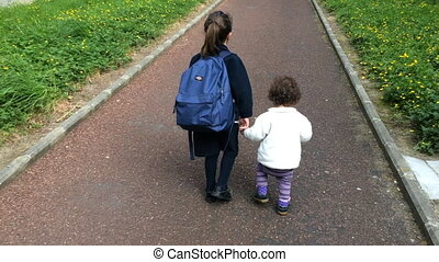 Sisters walks to school - Young sister girl age 1-5 walks...