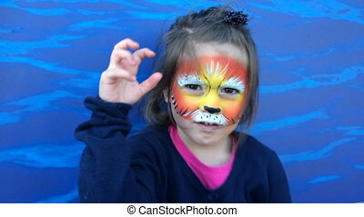 Girl with lion face painting - Little child girl age 5-6...