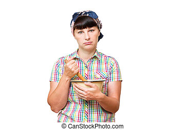 Tired woman with utensils in hand on white background.