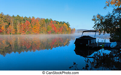 Fall colors reflected on the lake - Colorful leaves...