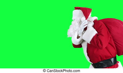 Santa Claus with gift bag - Santa is carries a red sack of...