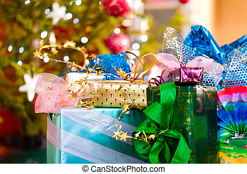 Christmas gifts under x-mas tree - Colorful Christmas gifts...