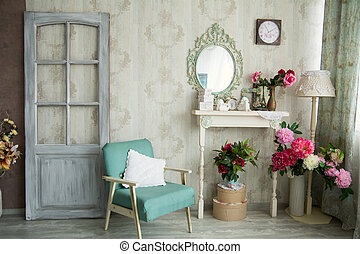 Vintage country house interior with mirror and a table with...