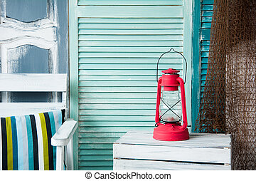 Vintage red kerosene lamp on the background of the old...