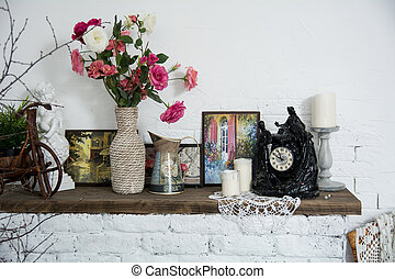Interior design vases with flowers and candles clock brick...