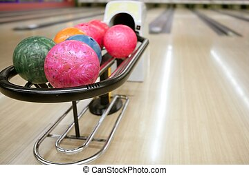Bowling balls and wooden floor perspective