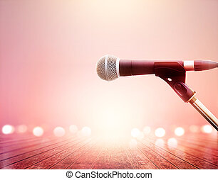 Microphone on vibrant lighting concert, wooden floor background, soft and blur
