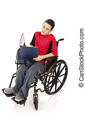 Teen Boy in Wheelchair Studying - Disabled teen boy doing...