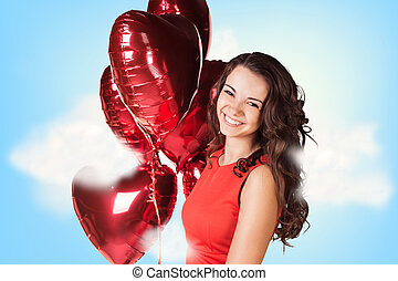 Young woman in red dress with balloons - Young beautiful...