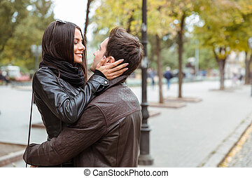 Woman embracing with her boyfriend outdoors - Portrait of a...