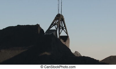 Bucket gathering coal. Close-up - Coke and Chemicals plant...