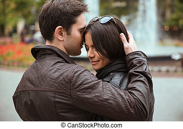 Couple hugging outdoors - Portrait of a beautiful couple...