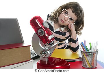 student little girl with microscope and laptop