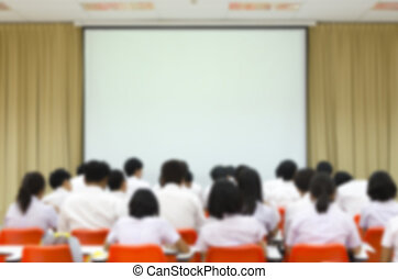 Blurred abstract background of university students sitting in a lecture room