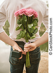 Valentines day Man hiding behind a bouquet of flowers...