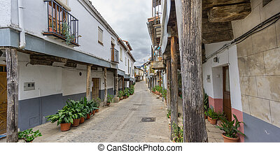 Guadalupe vintage streets with wooden columns in Spain -...