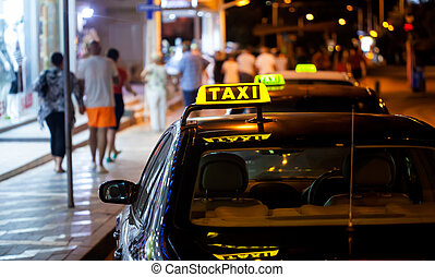 Taxi sign at night - Taxi sign on a car at night