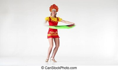 Young woman wearing a folk costumes dancing on white in full...