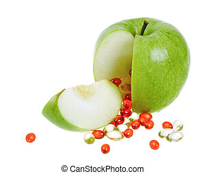 Apple with vitamin capsules