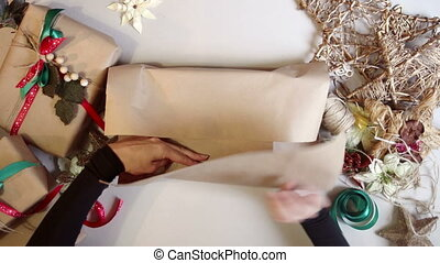 Woman wrapping christmas presents time lapse - Top view...