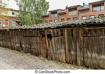 ramshackle wooden warehouses - old and ramshackle wooden...