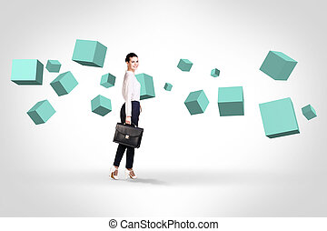 Business woman looking at turquoise cubes - Business woman...
