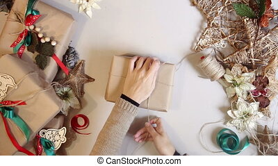 Top view. wrapping christmas presents. time lapse - Top view...