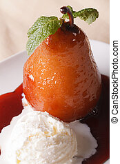 Pear poached in wine sauce with vanilla ice cream close-up. vertical