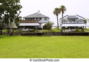 American houses in south Texas river boats - American houses...