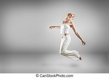 Jumping woman - Beautiful blonde jumping woman