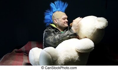 Funny punk with teddy bear - Video of funny punk on studio