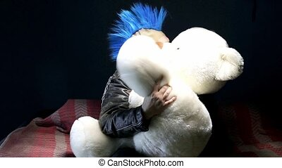 Funny punk with toy bear - Video of funny punk on studio