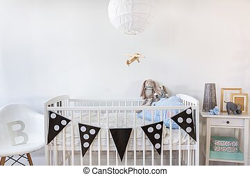 White cot with decoration - Image of white baby cot with...