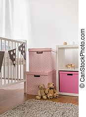 White cot and pink boxes - Photo of white cot and pink boxes...