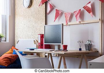 Desk with desktop computer in teen room