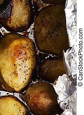 Baked potatoes above view - Baked in foil potatoes above...
