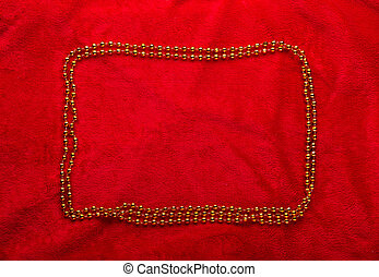 Christmas golden frame on red background.