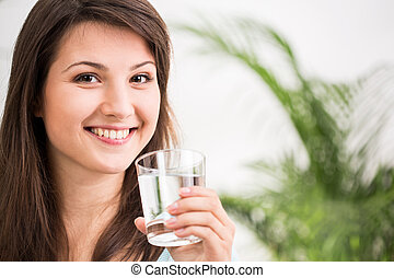 Fit girl drinking mineral water - Fit girl drinking glass of...