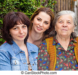 Family portrait - daughter granddaughter and grandmother -...