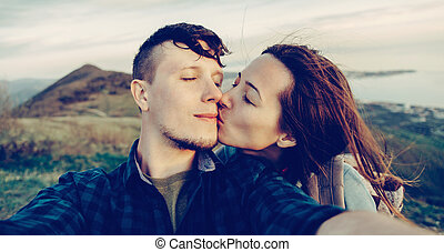 Self-portrait of loving couple outdoor - Traveler young...
